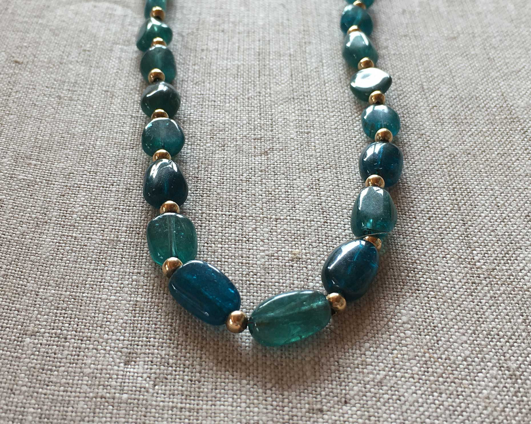 ewelry by Tibby Speare hanging in Pine Moon Fine Art.Apatite Tibby