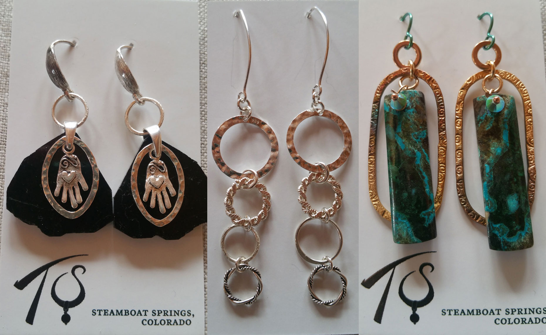 jewelry by Tibby Speare hanging in Pine Moon Fine Art. TibbyEarrings