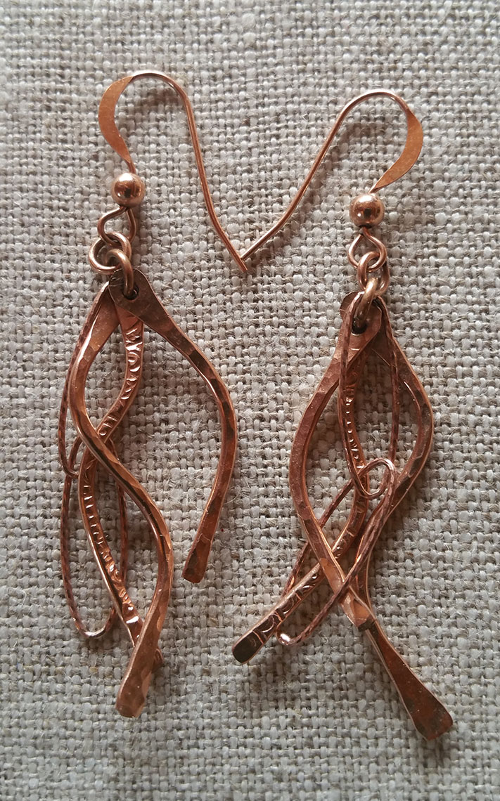 jewelry by Tibby Speare hanging in Pine Moon Fine Art.Lifelines earrings